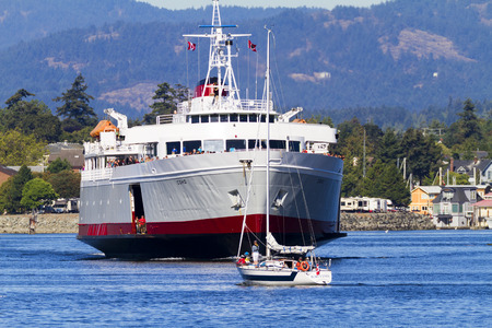 aboard: VICTORIA, BC, CANADA - AUG 12 2016: Travel between Seattle and Victoria, BC is fast and convenient aboard passenger ferry Coho. Victoria is one of the tourist destination Editorial