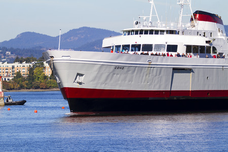 VICTORIA, BC, CANADA - AUG 12 2016: Travel between Seattle and Victoria, BC is fast and convenient aboard passenger ferry Coho. Victoria is one of the tourist destination Editorial
