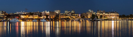 victoria bc: VICTORIA, BC, CANADA - AUG 16 2016. Victorias charm and beauty has a lot to offer for any world traveler. Street lights reflect in water at Inner Harbor