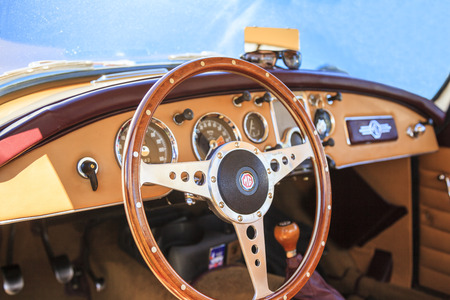 brit: WINGS & WHEELS CALGARY CANADA 21 6 2015:Fathers Day Weekend where some vintage Cars and Air crafts on display. An MGs interior and dashboard on display Editorial
