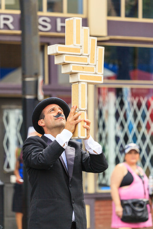 instrumentalist: CALGARY, CANADA JULY 20 2014: An unidentified performer participates at the annual Sun and Salsa at Kensington festival in Calgary. Editorial