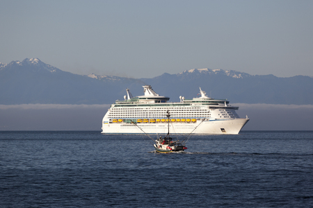 hundreds: VICTORIA, BC, CANADA - MAY 17 2016. Explorer of the Seas in Victoria. Each year hundreds of cruise ships docks in for a day or a few hours. Ogden Point is also the place to see them come into port.