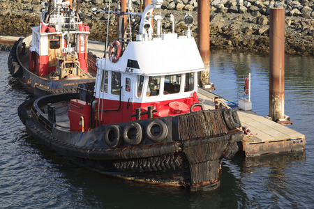 maneuvering: VICTORIA, BC, CANADA - MAY 7 2016: Classic tug boat are common vassals in the pictures Victoria. Those ships are for truism and plays an important part in the industry.