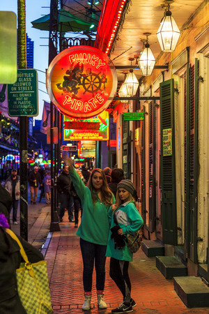 NEW ORLEANS, LOUISIANA USA- JAN 23 2016: Pubs and Bars having colorful lights and decorations in the French Quarter. Tourism provides a much needed financial source, also home for great musicians. Editorial