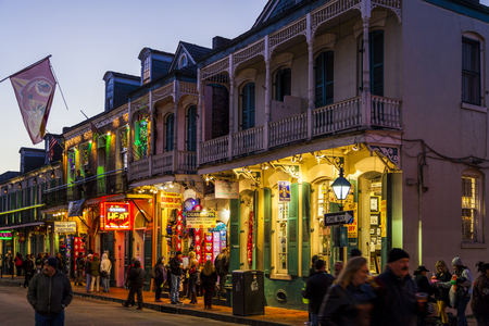 bourbon street: NEW ORLEANS, LOUISIANA USA- JAN 23 2016: Pubs and Bars having colorful lights and decorations in the French Quarter. Tourism provides a much needed financial source, also home for great musicians. Editorial