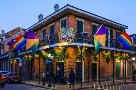 NEW ORLEANS, LOUISIANA USA- JAN 23 2016: Pubs and Bars having colorful lights and decorations in the French Quarter. Tourism provides a much needed financial source, also home for great musicians. Editöryel