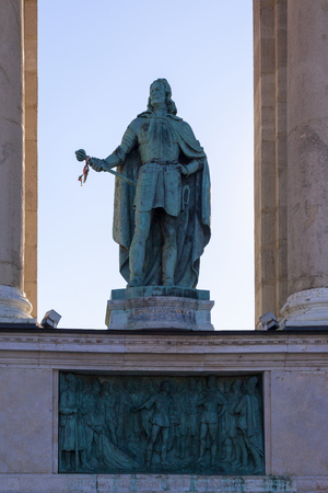 predecessor: At center of Heroes Square stands Millennium Monument. Behind Monument is a semicircular colonnade with statues of famous men who made their mark on Hungarian history. Budapest. Hungary.