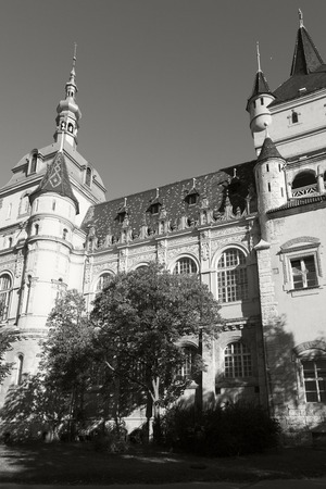 BUDAPEST, HUNGARY - SEPTEMBER 23, 2016: Tourist visiting Vajdahunyad Castle in the City Park of Budapest. It is designed in different styles: Romanesque, Gothic, Renaissance and Baroque.