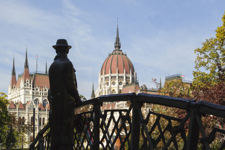 BUDAPEST HUNGARY 28 SEPT 2016: Memorial statue of Imre Nagy, standing on a symbolic arch bridge and looking towards the Hungarian Parliament. Installed in 1996 in Budapest.