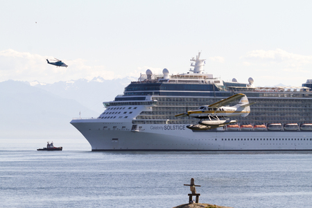 hundreds: VICTORIA, BC, CANADA - AUG 11 2016. Cruise ship in Victoria. Each year hundreds of cruise ships docks in for a day or two. Victorias charm and beauty has a lot to offer for any world traveler. Editorial