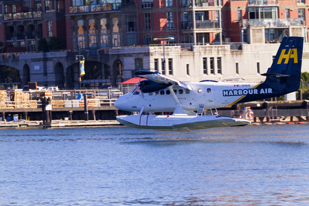 VICTORIA, BC, CANADA - JUN 24 2016: Royals Victoria Float-plane in the inner harbor. This transportation is vital and very frequent between Vitoria and Vancouver, also the flight is very pictures.