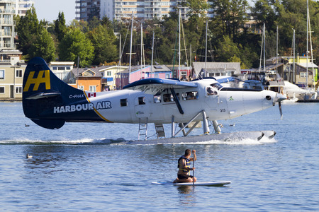 hydroplane: VICTORIA, BC, CANADA - AUG. 24 2016: Royals Victoria Float-plane in the inner harbor. This transportation is vital and very frequent between Vitoria and Vancouver, also the flight is very pictures.