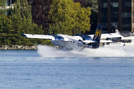 VICTORIA, BC, CANADA - AUG. 24 2016: Royals Victoria Float-plane in the inner harbor. This transportation is vital and very frequent between Vitoria and Vancouver, also the flight is very pictures.