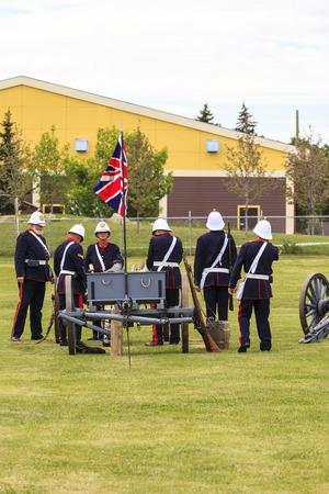 CALGARY, CANADA - JUN 13: Exhibits outside the Military Museums in Calgary, Alberta Canada. It is made of museums dedicated to representing Canadas navy, army, and air force. Soldiers with cannon.