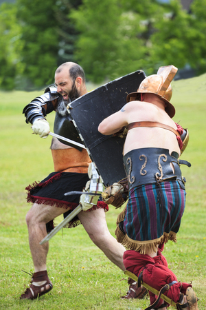 CALGARY CANADA JUN 13 2015:  The Military Museum organized Summer Skirmish event where an unidentified soldier is seen  in a historical Reenactment Battle. Gladiator fight.