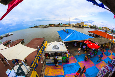 BELIZE - JAN 26 2016: Port of Belize City once was once the capital of the former British Honduras. A colorful place for tourists and fun lovers Editorial