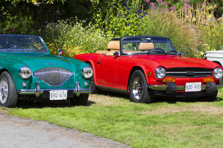 Victoria Canada Sept. 10, 2017: One of the largest collection of classic British cars on display at the Government House in Victoria. Editorial