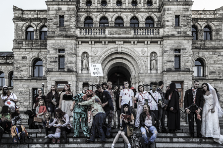 VICTORIA CANADA OCT 7 2017: People in costumes are on the Zombies walk in Victoria down town during the annual Zombie Walk . Sajtókép