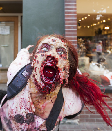 VICTORIA CANADA OCT 7 2017: People in costumes are on the Zombies walk in Victoria down town during the annual Zombie Walk . Redakční
