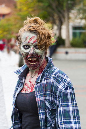 VICTORIA CANADA OCT 7 2017: People in costumes are on the Zombies walk in Victoria down town during the annual Zombie Walk . Editorial