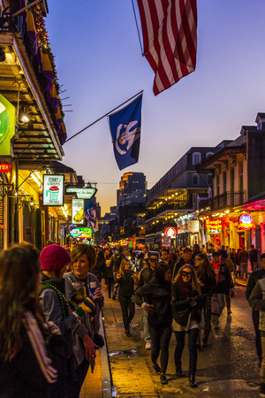 NEW ORLEANS, LOUISIANA USA- FEB 2 2016: Pubs and Bars having colorful lights and decorations in the French Quarter. Tourism provides a much needed financial source, also home for great musicians. Editorial