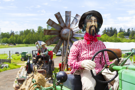 A farmer puppet on a float awaiting for the Victoria Day Parade along Douglas Street.