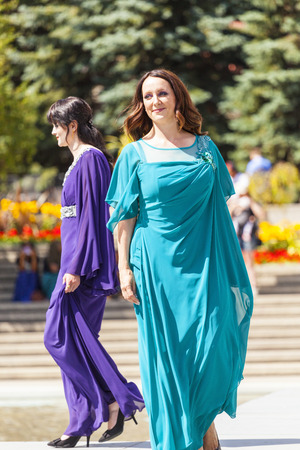 Calgary Canada Aug 10 2014: Models are showing Arab style fashion in public place at Olympic Plaza.