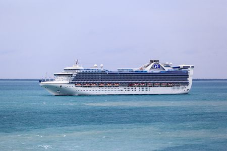 BELIZE. JAN 26 2016: Caribbean Princess Cruise Ship anchors near Belize City and ready to tender visitors to the port . She has capacity about 3000 passengers and crew of 1150 - Image Editorial