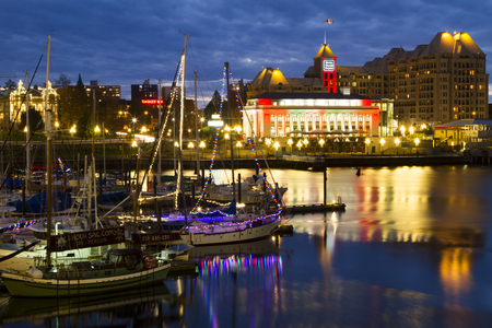 VICTORIA CANADA DEC 1 2016: Christmas night view of the Inner Harbor Downtown. Tourists strolling the causeway. This waterfront is the location of many tourist attractions and recreational activities. Editorial