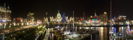 VICTORIA CANADA DEC 20 2016: Inner harbor. The city is decorated for Christmas. People are shopping in downtown. Victorias charm and beauty has a lot to offer to any world traveler.