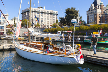 VICTORIA BC CANADA SEPT 3 2017: Vintage boat sails on the Victoria Classic Boat Festival. This vintage boat took part of the Annual Sail Day Event.