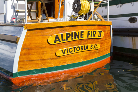 VICTORIA BC CANADA SEPT 3 2017: Vintage boat sails on the Victoria Classic Boat Festival. This vinta