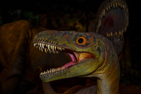 CALGARY, CANADA - 16, 2014: The Calgary ZOO exhibition of Prehistoric Park attract young and old to Imagine what it would be like back in Cretaceous Period (millions of years ago). 新聞圖片