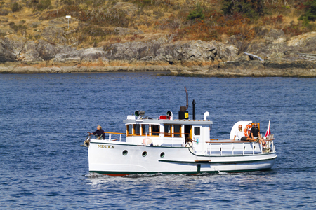 Victoria BC Canada Sept 3 2016: Annual Victoria Classic Boat Festival attract many owners and visitors from Canada, USA. There are many crafts on display and sailing on the last day tops the event.. 新闻类图片