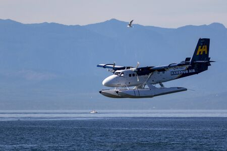 VICTORIA, BC, CANADA - JUL 16 2016: Harbor Air Float-plane in the inner harbor. This transportation is vital and very frequent between Vitoria and Vancouver, also the flight is very pictures.
