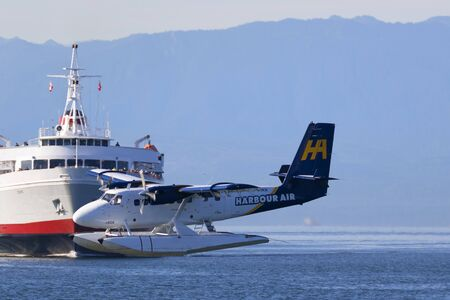 Victoria, BC, Canada - Sept 11 2016. Float-plane traffic in the inner harbor. This transportation is vital and very frequent between Vitoria and Vancouver, also the flight is very pictures.