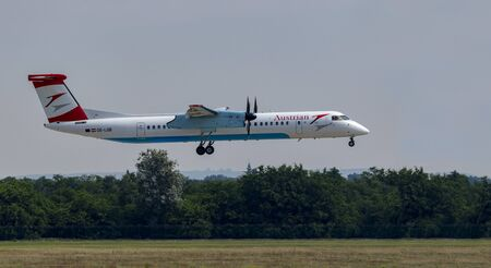 Budapest Hungary July 28 2019: Austrian Airline Dash 8-402 OE-LGB just landing at Budapest International airport.