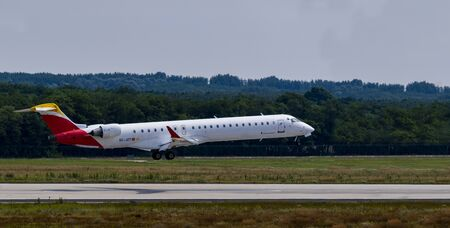 Budapest Hungary July 24 2019: Air Nostrum Airline Embraer 145 EC-JZT just landing at Budapest International airport. Editorial