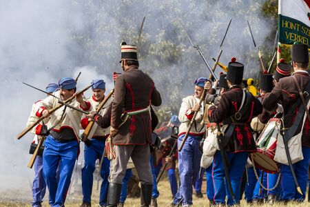 Pákozd Hungary Sept 29, 2019: Unidentified reenactors fighting the historic war of Independence of 1848 in Hungary. That battle was won -however, the freedom was short-lived. Stok Fotoğraf - 133786753
