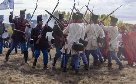 Pákozd Hungary Sept 29, 2019: Unidentified reenactors fighting the historic war of Independence of 1848 in Hungary. That battle was won -however, the freedom was short-lived. Stok Fotoğraf - 133787004