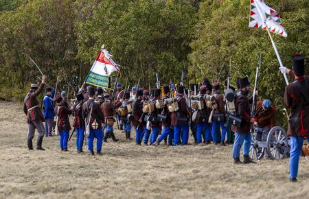 Pákozd Hungary Sept 29, 2019: Unidentified reenactors fighting the historic war of Independence of 1848 in Hungary. That battle was won -however, the freedom was short-lived. Stok Fotoğraf - 133787001
