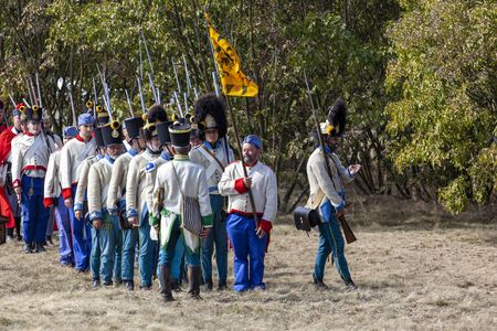 Pákozd Hungary Sept 29, 2019: Unidentified reenactors fighting the historic war of Independence of 1848 in Hungary. That battle was won -however, the freedom was short-lived. Stok Fotoğraf - 133786963