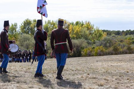 Pákozd Hungary Sept 29, 2019: Unidentified reenactors fighting the historic war of Independence of 1848 in Hungary. That battle was won -however, the freedom was short-lived. Stok Fotoğraf - 133786966