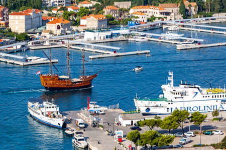 Dubrovnik West harbor Croatia sept 14, 2019: Replica of a old sailboat- used by tourists - sailing out from the West harbor. Panoramic view from the hillside