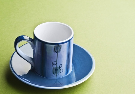 Close-up of a saucer with a tea cup photo