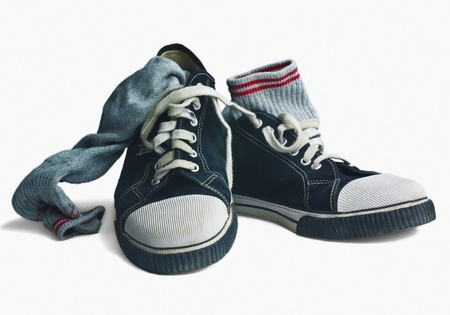 Close-up of a pair of canvas shoes with socks photo