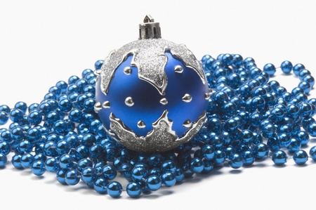 Blue bauble on string of blue beads photo