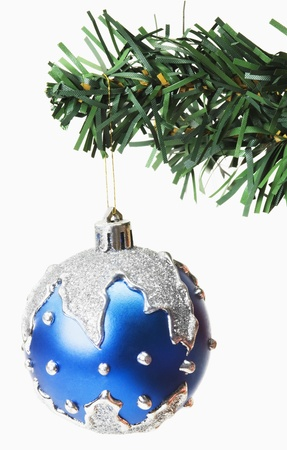 decorating christmas tree: Blue bauble hanging on a Christmas tree