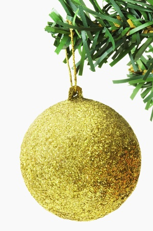 Golden bauble hanging on a Christmas tree photo