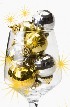 Close-up of baubles in a wine glass photo